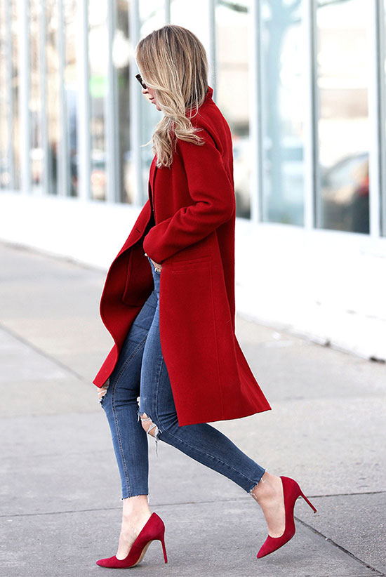 20 Cute Valentine's Day Outfits For Every Situation: Fashion blogger 'Brooklyn Blonde' wearing a red coat, a black sweater, skinny jeans, red heels and black sunglasses. Fall outfit, winter outfit, casual outfit, street style, street chic style, office outfit, work outfit, valentine's day outfit, casual valentine's day outfit, holiday outfit, casual holiday outfit.