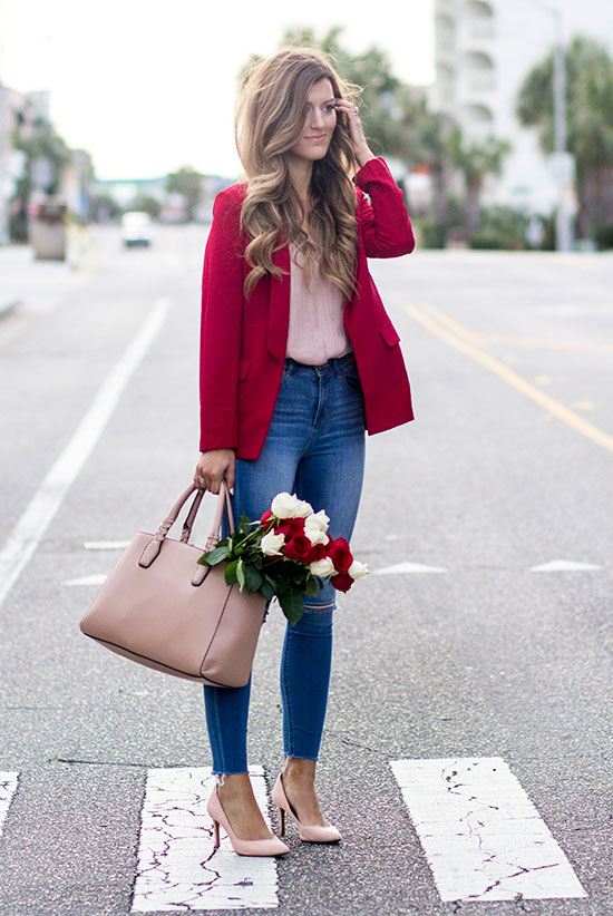 20 Cute Valentine's Day Outfits For Every Situation: Fashion blogger 'Chic Street Style' wearing a red blazer, a pink blouse, skinny jeans, pink heels and a nude handbag. Street style, street chic style, valentine's day outfit, casual valentine's day outfit, office outfit, work outfit, romantic outfit.