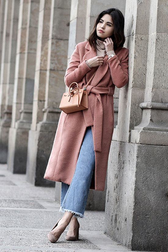 20 Cute Valentine's Day Outfits For Every Situation: Fashion blogger 'Fake Leather' wearing a pink coat, a white turtleneck sweater, crop flare jeans, nude heels and a pink mini bag. Street style, fall outfit, winter outfit, casual outfit, date night outfit, night out outfit, romantic outfit, valentine's day outfit, casual valentine's day outfit