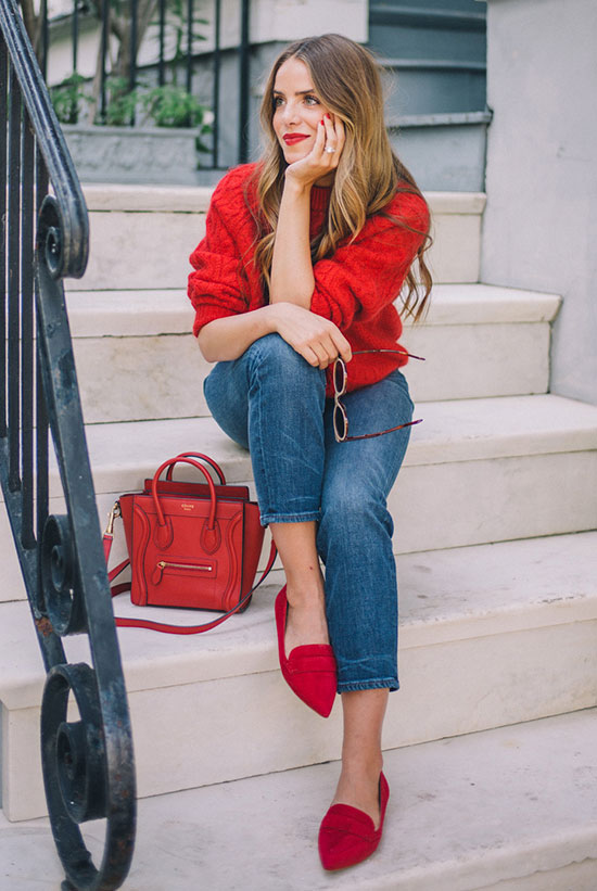 20 Cute Valentine's Day Outfits For Every Situation: Fashion blogger 'Gal Meets Glam' wearing a red sweater, crop jeans, red flats and a red mini bag. Street style, comfy outfit, fall outfit, spring outfit, casual outfit, holiday outfit, valentine's day outfit, casual holiday outfit, casual valentine's day outfit, romantic outfit.