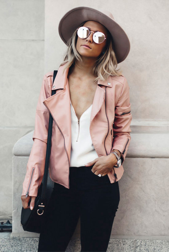 20 Cute Valentine's Day Outfits For Every Situation: Fashion blogger 'Jo & Kemp' wearing a nude fedora, a pink leather jacket, a white blouse, black skinny jeans, black booties, mirror sunglasses and a black shoulder bag. Street style, spring outfit, fall outfit, leather jacket outfit, casual outfit, boho chic outfit, valentine's day outfit, casual valentine's day outfit.