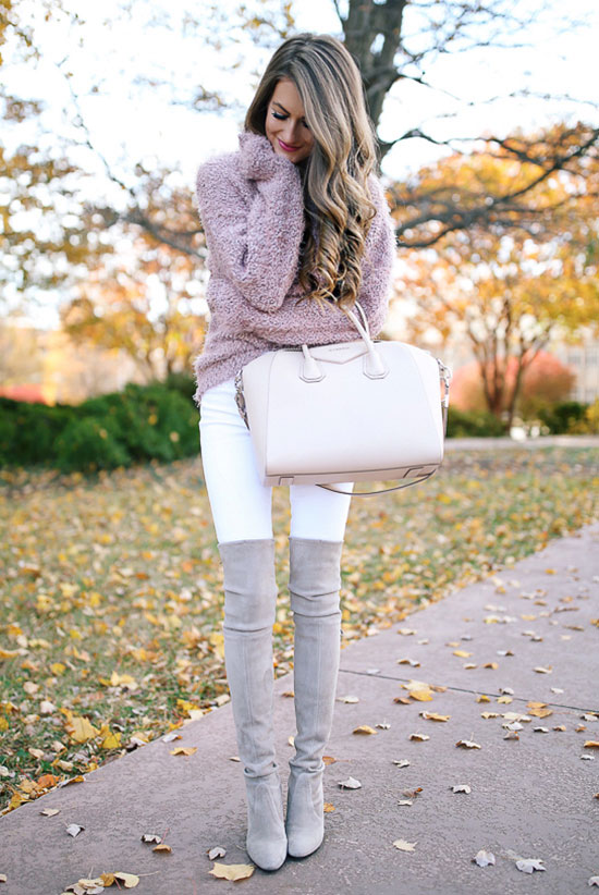 20 Cute Valentine's Day Outfits For Every Situation: Fashion blogger 'Southern Curls & Pearls' wearing a pink sweater, white skinny jeans, and grey over the knee boots. Fall outfit, winter outfit, casual outfit, night out outfit, valentine's day outfit, casual valentine's day outfit.
