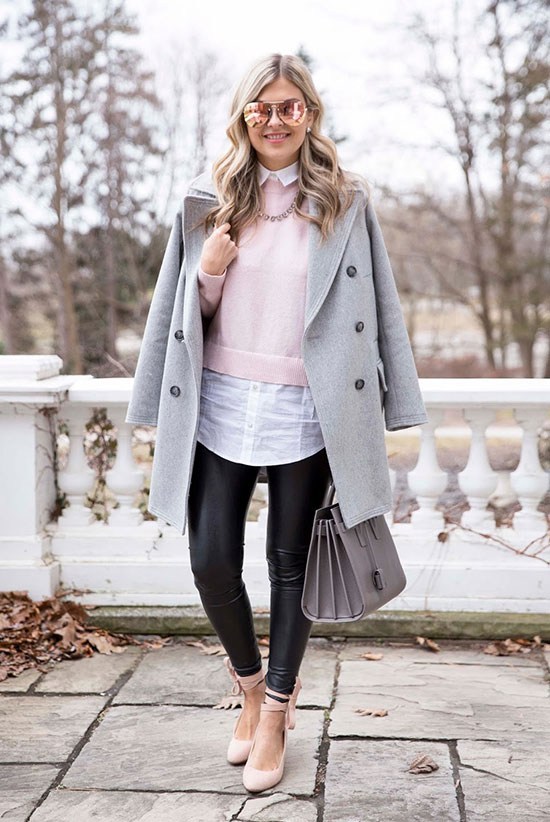 20 Cute Valentine's Day Outfits For Every Situation: Fashion blogger 'Suburban Faux Pas' wearing a grey coat, a pink sweater (blush sweater), a white long shirt, black leather leggings, blush heels, a grey handbag and pink sunglasses. Fall outfit, winter outfit, casual outfit, office outfit, work outfit, valentine's day outfit, fall layers, winter layers, grey coat outfit, leather leggings outfit.