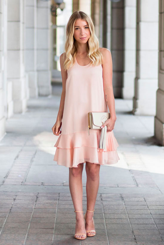 20 Cute Valentine's Day Outfits For Every Situation: Fashion blogger 'The Blondie Locks' wearing a pink sleeveless dress (blush sleeveless dress), nude heeled sandals (nude heels) and a white clutch. Spring outfit, summer outfit, formal outfit, date night outfit, party outfit, romantic date outfit, valentine's day outfit.
