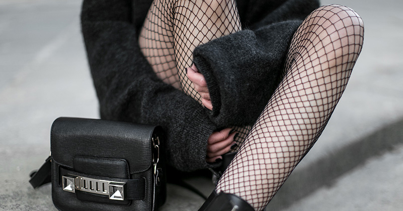 How To Wear Fishnet Tights in 15 Stylish Ways: Fashion blogger 'Worry About It Later' wearing a black fedora, black sunglasses, a grey oversized sweater dress, fishnet tights, combat boots and a black shoulder bag. Fall outfit, spring outfit, fall fashion trends, spring fashion trends, fashion trends, fashion trends 2017, casual outfit, comfy outfit, boho chic outfit, fishnet tight outfits.