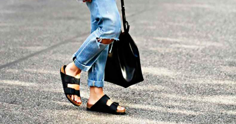 2 Spring-Perfect Lazy Girl Outfits Wearing Birkenstocks: Girl wearing a grey oversized sweatshirt, distressed boyfriend jeans, black Birkenstock sandals and a black bucket bag (Mansur Gavriel bucket bag).