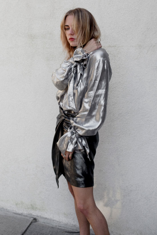 The Metallic Top, Two Ways: Fashion blogger 'Always Judging' wearing a silver top, a metallic mini skirt and black sock booties. Party outfit, night out outfit, metallic outfit, spring outfit, fall outfit, fashion trends 2017, spring fashion trends 2017, fall fashion trends 2017, statement sleeves outfit.