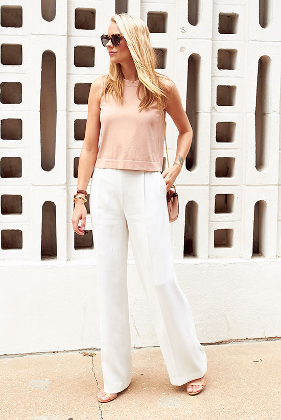 20+ Fresh & Chic Summer Work Outfits: Fashion blogger 'Fashion Jackson' wearing a beige sleeveless knit top, white wide leg pants, beige ankle strap sandals, brown sunglasses and a brown saddle bag. Work outfits, summer work outfits, outfits for work, office outfits, office wear, simple work outfits, work outfits 2017, fresh work outfits, neutral tone outfits.