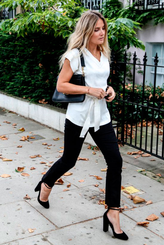 20+ Fresh & Chic Summer Work Outfits: Fashion blogger 'Fashion Me Now' wearing a white wrap top, black crop jeans, black ankle strap heels and a black shoulder bag. Work outfits, summer work outfits, outfits for work, office outfits, office wear, simple work outfits, work outfits 2017, fresh work outfits, monochrome outfits, black & white outfits.