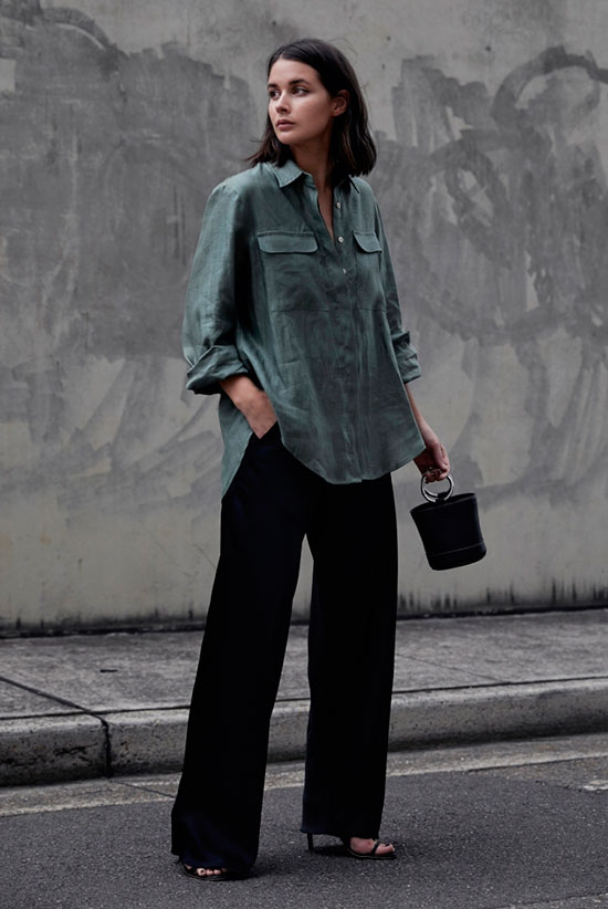 20+ Fresh & Chic Summer Work Outfits: Fashion blogger 'Harper & Harley' wearing a khaki oversized shirt, black wide leg pants, black ankle strap sandals and a black metallic handle mini bag. Work outfits, summer work outfits, outfits for work, office outfits, office wear, simple work outfits, work outfits 2017, spring work outfits, fall work outfits, minimal outfits.