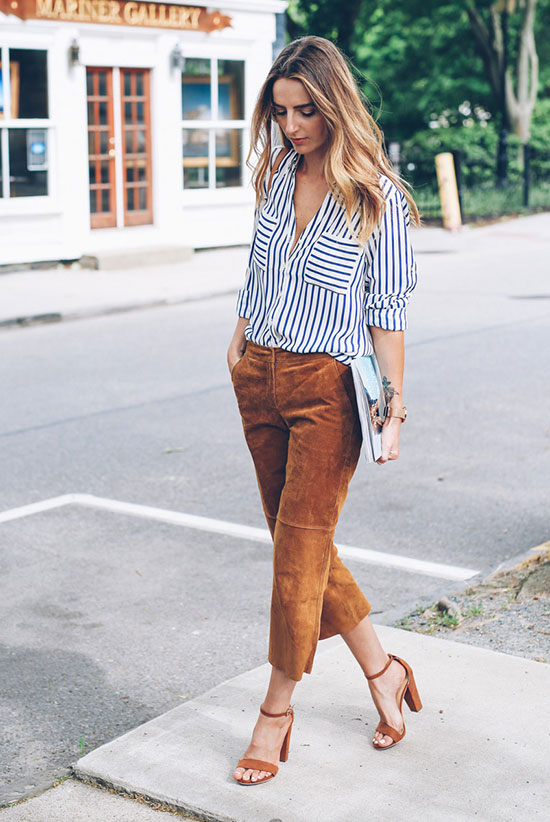 20+ Fresh & Chic Summer Work Outfits: Fashion blogger 'Jess Ann Kirby' wearing a blue stripe shirt, brown suede crop pants, brown suede ankle strap sandals and a white clutch. Work outfits, summer work outfits, outfits for work, office outfits, office wear, simple work outfits, work outfits 2017, spring work outfits.