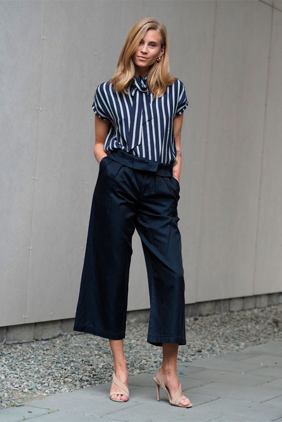20+ Fresh & Chic Summer Work Outfits: Fashion blogger 'The fashion Eaters' wearing a navy stripe short sleeve top, navy wide leg crop pants and beige heeled sandals. Work outfits, summer work outfits, outfits for work, office outfits, office wear, simple work outfits, work outfits 2017.
