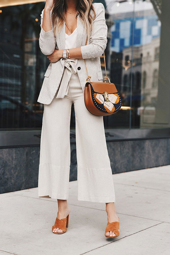 20+ Fresh & Chic Summer Work Outfits: Fashion blogger 'The Girl From Panama' wearing a beige blazer, a white cami top, beige wide leg crop pants, brown suede peep toe mules and a brown saddle bag. Work outfits, summer work outfits, outfits for work, office outfits, office wear, simple work outfits, work outfits 2017, spring work outfits, neutral tone outfits.