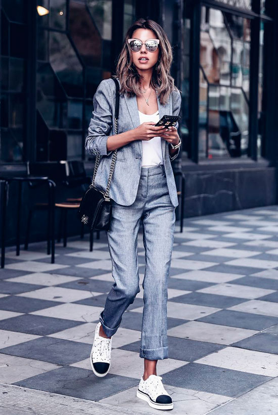 20+ Fresh & Chic Summer Work Outfits: Fashion blogger 'Viva Luxury' wearing a grey blazer, grey crop pants, a white cami top, white cap toe oxfords, white cat eye sunglasses and a black shoulder bag. Work outfits, summer work outfits, outfits for work, office outfits, office wear, simple work outfits, work outfits 2017, spring work outfits, comfy work outfits.