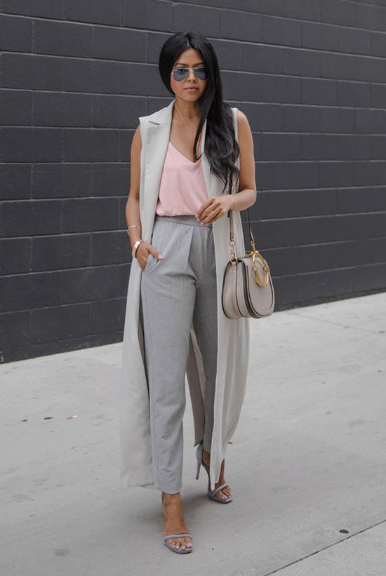 20+ Fresh & Chic Summer Work Outfits: Fashion blogger 'Walk In Wonderland' wearing a grey sleeveless duster coat, a blush cami top, grey crop pants, grey ankle strap sandals, a grey saddle bag and silver aviator sunglasses. Work outfits, summer work outfits, outfits for work, office outfits, office wear, simple work outfits, work outfits 2017, fresh work outfits.