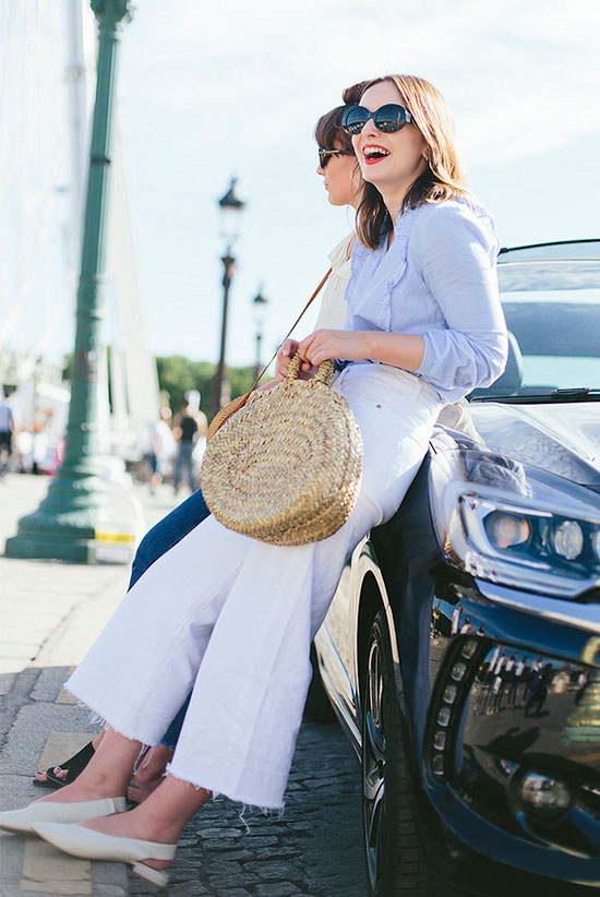 20+ Fresh & Chic Summer Work Outfits: Fashion blogger 'What Olivia Did' wearing a pale blue blouse, white wide leg crop jeans, white slingback flats, black sunglasses and a straw bag. Work outfits, summer work outfits, outfits for work, office outfits, office wear, simple work outfits, work outfits 2017, comfy work outfits.