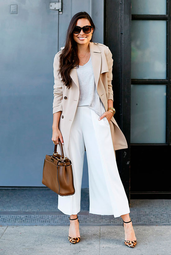 20+ Fresh & Chic Summer Work Outfits: Fashion blogger 'With Love From Kat' wearing a beige trench coat, a grey cami top, white wide leg crop pants, leopard print heels, brown sunglasses and a brown handbag. Work outfits, summer work outfits, outfits for work, office outfits, office wear, simple work outfits, work outfits 2017, spring work outfits, trench coat outfits, neutral tone outfits.