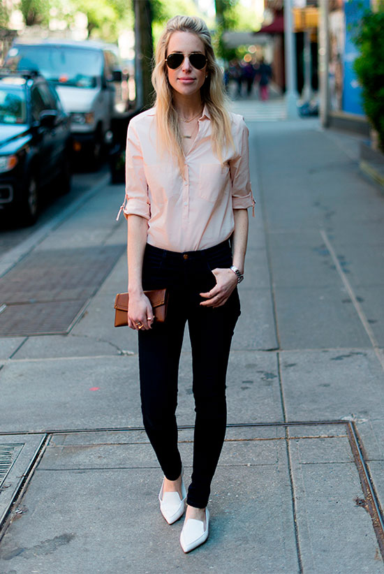 20+ Fresh & Chic Summer Work Outfits: Fashion blogger 'Yael Steren' wearing a blush shirt, black skinny jeans, white pointy toe loafers, a brown clutch and brown aviator sunglasses. Work outfits, summer work outfits, outfits for work, office outfits, office wear, simple work outfits, work outfits 2017, spring work outfits, for the office, comfy work outfits.