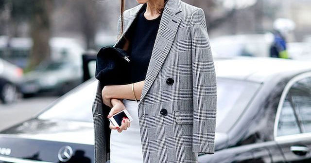 The Blazer You Absolutely Need This Fall: Woman wearing a grey check blazer, a black blouse, a white pencil skirt, black heels and a black clutch. Fall outfits, fall fashion trends 2017, fall trends 2017, grey blazer outfits, check blazer outfits, plaid blazer outfits, glen plaid blazer, prince of wales blazer, work outfits, office wear, office outfits, business casual, interview outfits, fall work outfits, street style.