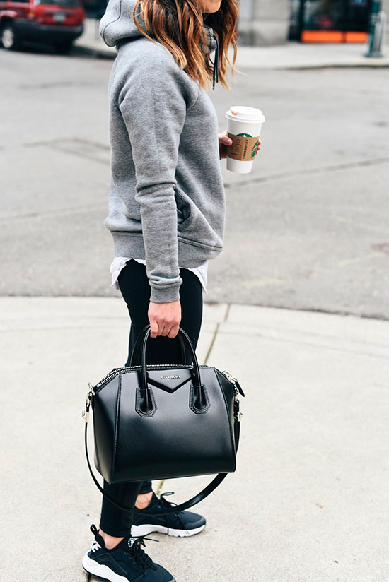 5 Ultra Comfy Sneakers Outfits Perfect For Fall: Fashion blogger 'Crystalin Marie' wearing a grey hoodie, a white t-shirt, black leggings, black sneakers, black aviator sunglasses and a black handbag. Fall outfits, comfy outfits, sneakers outfits, athleisure, athleisure outfits, weekend outfits, back to school outfits, casual outfits, travel outfits, nike huarache sneakers, nike huarache outfits, black sneakers outfits.
