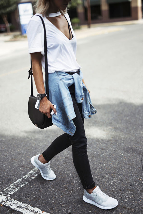 5 Ultra Comfy Sneakers Outfits Perfect For Fall: Fashion blogger 'Jo & Kemp' wearing a white keyhole t-shirt, a chambray shirt, black skinny jeans, grey sneakers and a black saddle bag. Fall outfits, comfy outfits, sneakers outfits, athleisure, athleisure outfits, weekend outfits, back to school outfits, casual outfits, travel outfits, adidas swift sneakers, adidas swift outfits, grey sneakers outfits.