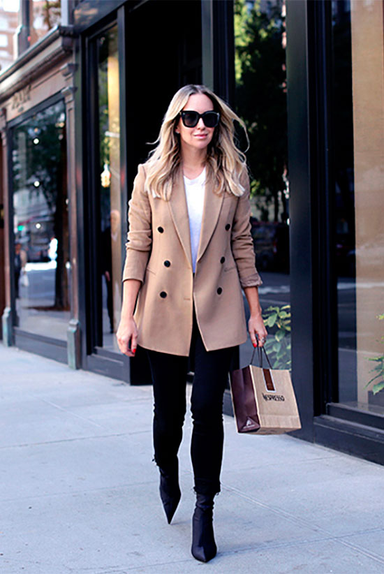 40 Ultra-Chic Fall Outfits To Try Right Now: Fashion blogger 'Brooklyn Blonde' wearing a camel coat, a white sweater, black raw hem crop skinny jeans, black sock booties and black sunglasses. Fall outfits, fall fashion trends 2017, fall fashion, street style, work outfits, business casual, office wear, simple outfits, timeless outfits, chic outfits, casual outfits.