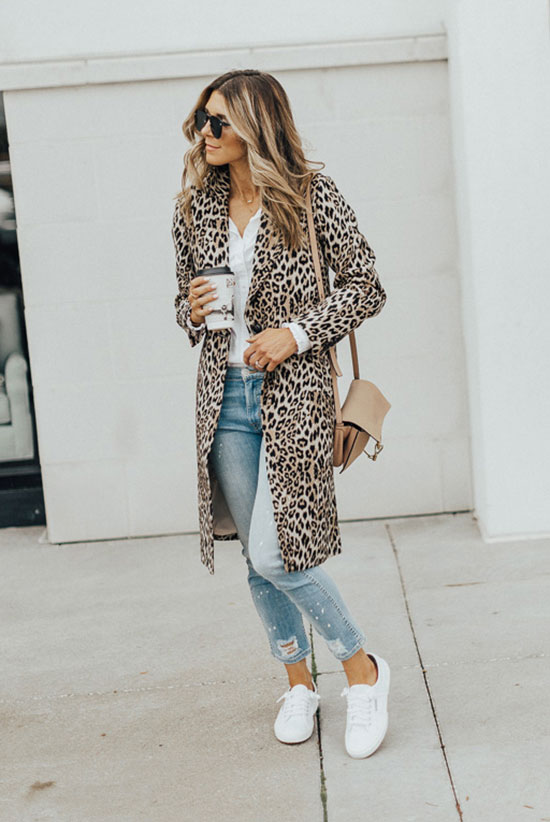 40 Ultra-Chic Fall Outfits To Try Right Now: Fashion blogger 'Cella Jane' wearing a leopard coat, a white shirt, distressed skinny jeans, white sneakers and a beige shoulder bag. Fall outfits, fall fashion trends 2017, fall fashion, street style, casual outfits, comfy outfits, weekend outfits.