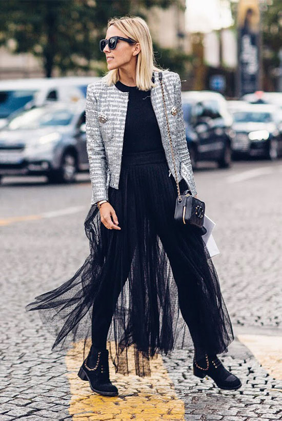 40 Ultra-Chic Fall Outfits To Try Right Now: Fashion blogger 'Damsel In Dior' wearing a grey tweed jacket, a black sweater, a black tulle maxi skirt, black leggings, black studded booties and a black chain strap bag. Fall outfits, fall fashion trends 2017, fall fashion, street style, party outfits, comfy outfits, trendy outfits, fashion week outfits.
