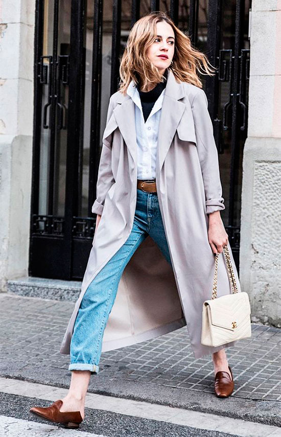 40 Ultra-Chic Fall Outfits To Try Right Now: Fashion blogger 'Dansvogue' wearing a beige trench coat, a white shirt, a black turtleneck sweater, straight jeans, a brown belt, brown loafers and a beige chain strap bag. Fall outfits, fall fashion trends 2017, fall fashion, street style, fall layers, casual outfits, comfy outfits, layered outfits, trench coat outfits, timeless outfits.