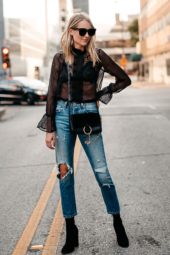 40 Ultra-Chic Fall Outfits To Try Right Now: Fashion blogger 'Fashion Jackson' wearing a black long sleeve mesh blouse, distressed crop jeans, black suede booties, black sunglasses and a black shoulder bag. Fall outfits, fall fashion trends 2017, fall fashion, street style, party outfits, night out outfits, casual outfits, chic outfits, trendy outfits, holiday outfits.