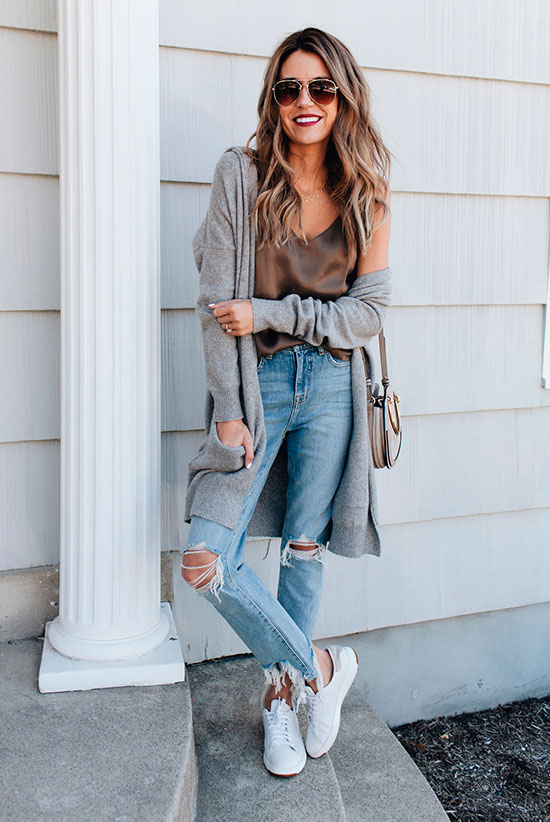 40 Ultra-Chic Fall Outfits To Try Right Now: Fashion blogger 'Hello Fashion' wearing a grey long cardigan, a brown cami top, distressed straight jeans, white sneakers, aviator sunglasses and a nude shoulder bag. Fall outfits, fall fashion trends 2017, fall fashion, street style, casual outfits, comfy outfits, sneakers outfits, cardigan outfits, simple outfits, fall layers.