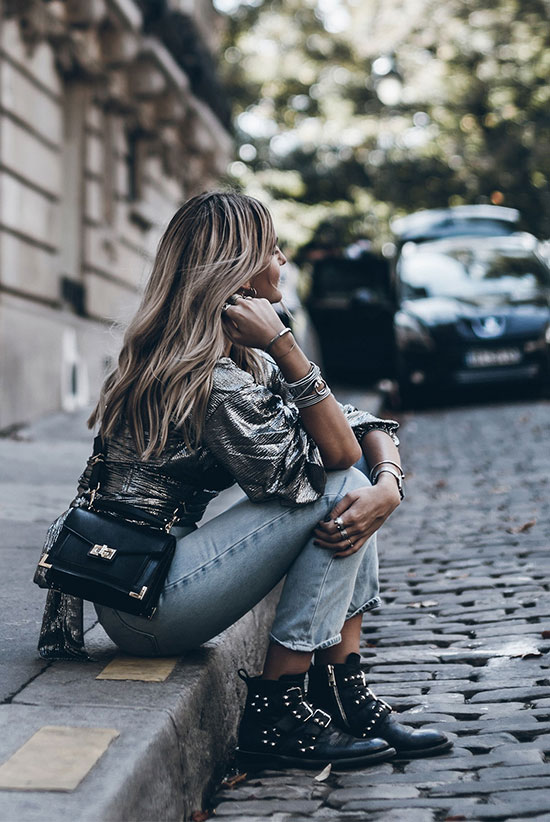40 Ultra-Chic Fall Outfits To Try Right Now: Fashion blogger 'Mikuta' wearing a metallic long sleeve top, straight jeans, black studded booties and a black shoulder bag. Fall outfits, fall fashion trends 2017, fall fashion, street style, trendy outfits, casual outfits, comfy outfits, dinner outfits.