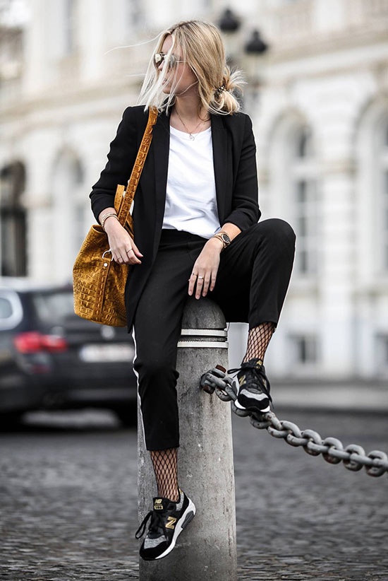 40 Ultra-Chic Fall Outfits To Try Right Now: Fashion blogger 'Milky Ways Blue Eyes' wearing a black blazer, a white t-shirt, black track pants, fishnet tights, black sports sneakers and a yellow bucket bag. Fall outfits, fall fashion trends 2017, fall fashion, street style, comfy outfits, casual outfits, trendy outfits, back to school outfits, travel outfits.