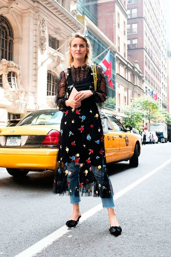 40 Ultra-Chic Fall Outfits To Try Right Now: Woman wearing a black embroidered mesh midi dress over raw hem crop jeans and black bow mules. Fall outfits, fall fashion trends 2017, fall fashion, street style, comfy outfits, dinner outfits, trendy outfits, casual outfits, dinner outfits.