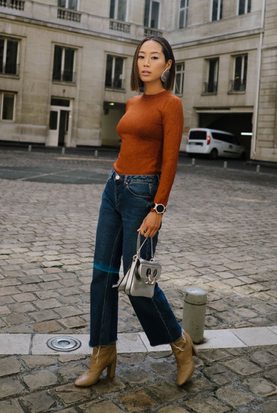40 Ultra-Chic Fall Outfits To Try Right Now: Fashion blogger 'Song Of Style' wearing an orange mock neck top, wide leg crop jeans, beige leather booties and a white shoulder bag. Fall outfits, fall fashion trends 2017, fall fashion, street style, casual outfits, chic outfits.
