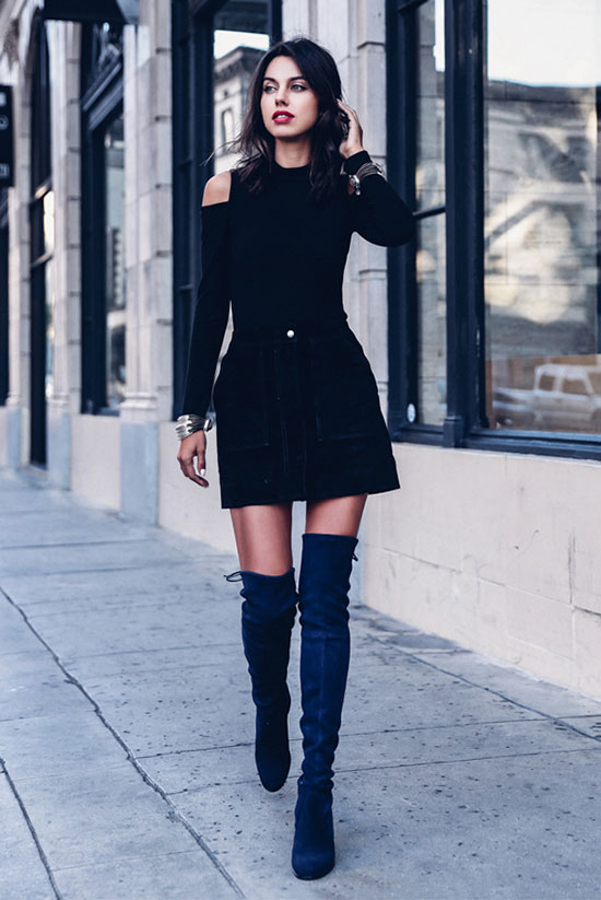 40 Ultra-Chic Fall Outfits To Try Right Now: Fashion blogger 'Viva Luxury' wearing a black cold shoulder top, a black suede mini skirt and navy suede over the knee boots. Fall outfits, fall fashion trends 2017, fall fashion, street style, party outfits, night out outfits, holiday outfits, dressy outfits.