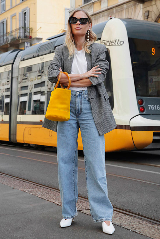 40 Ultra-Chic Fall Outfits To Try Right Now: Fashion blogger 'We The People' wearing a grey plaid blazer, a white t-shirt, wide leg jeans, white pumps, black sunglasses and a yellow bucket bag. Fall outfits, fall fashion trends 2017, fall fashion, street style, casual outfits, comfy outfits.