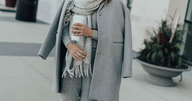 2 Cool Ways To Wear Joggers For Lounging: Fashion blogger 'Cella Jane' wearing a grey coat, a grey sweater, grey joggers, white running sneakers, a grey beanie, a grey scarf and black aviator sunglasses. Winter outfit, comfy outfit, weekend outfit, lazy day outfit, comfy outfit, lounging outfit, joggers outfit, fashion, winter fashion, travel outfit, fashion 2017, fashion trends 2017, street style.