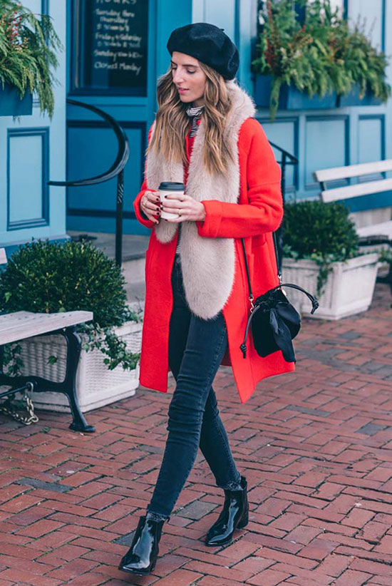 Red Coat Inspiration For a Bold Winter Look: Fashion blogger 'Jess Ann Kirby' wearing a black beret hat, a red coat, a stripe turtleneck top, black skinny jeans, black pointed booties, a beige faux fur scarf and a black mini bucket bag. Red coat, winter outfits, statement outfits, red coat outfits, winter fashion, winter fashion 2017, winter fashion trends 2017, fashion trends 2017, street style, casual outfits, comfy outfits, travel outfits, trendy outfits, holiday outfits.