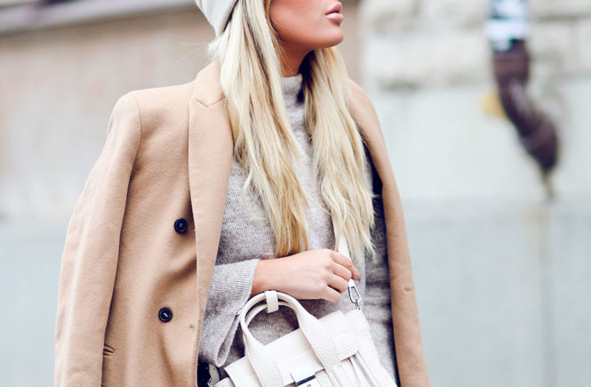 A Cozy-Chic Case For Timberland Boots: Fashion blogger 'Angelica Blick' wearing a grey beanie, a camel coat, a grey turtleneck sweater, white skinny jeans, brown timberland boots and a white shoulder bag. Timberland boots, Fashion, fashion 2018, lace up boots, fashion trends, fashion trends 2018, winter fashion, winter outfit, winter layers, cozy outfit, comfy outfit, casual outfit, winter casual outfit, street style, travel outfit.