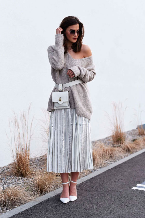 Sleek Ways To Style The Modern Fanny Pack: Fashion blogger 'Fashiioncarpet' wearing a grey oversized sweater, a silver pleated midi skirt, white heels and a white belt bag. Fanny pack, fanny pack outfit, belt bag, belt bag outfit, fashion trends 2018, fashion, fashion 2018, street style, casual outfit, chic street style outfit, fall outfit.