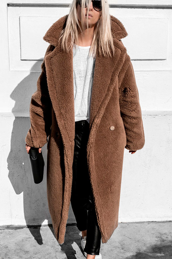 10 Simple Ways To Style A Long Coat: Fashion blogger 'Figtny' wearing a brown long teddy coat, a white t-shirt, black leather pants, white sneakers, black sunglasses and a black clutch.