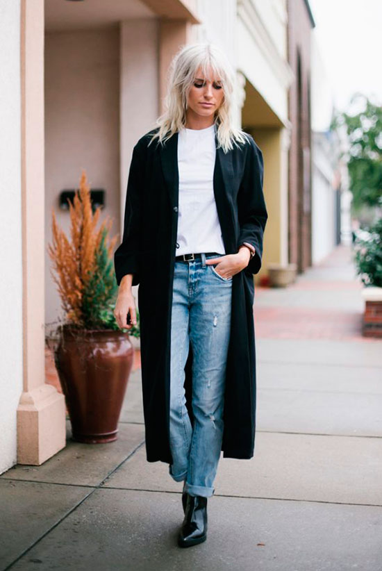 10 Simple Ways To Style A Long Coat: Fashion blogger 'Like The Yogurt' wearing a black long coat, a white t-shirt, straight jeans, a black belt, and black patent booties.
