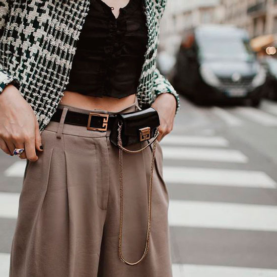 Sleek Ways To Style The Modern Fanny Pack: Fashion blogger 'Natalie Off Duty' wearing a houndstooth crop jacket, a v-neck crop top, beige culottes, black platform sandals and a black belt bag. Fanny pack, fanny pack outfit, belt bag, belt bag outfit, fashion trends 2018, fashion, fashion 2018, street style, casual outfit, chic street style outfit, fall outfit, spring outfit, party outfit.