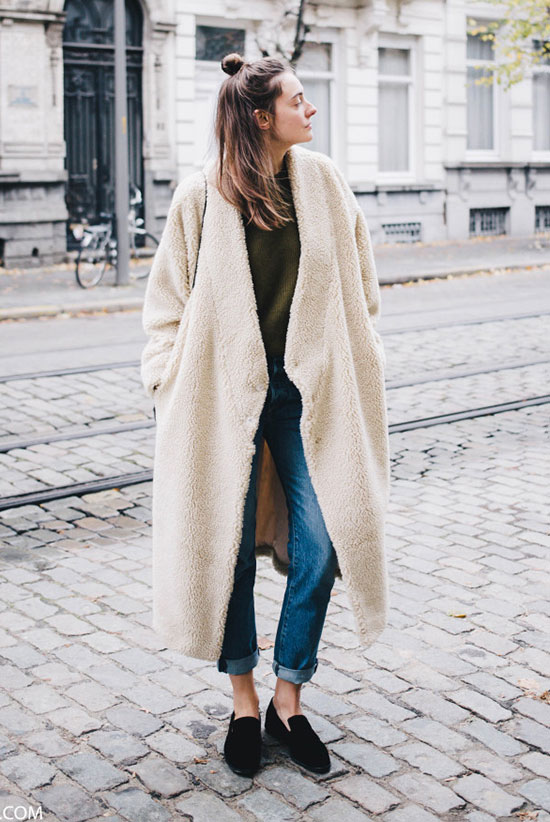 10 Simple Ways To Style A Long Coat: Fashion blogger 'Polienne' wearing a white long teddy coat, an olive sweater, straight jeans, and black loafers.