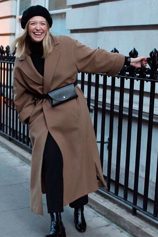 Sleek Ways To Style The Modern Fanny Pack: Fashion blogger 'Style Memos' wearing a black beret hat, a camel coat, a black turtleneck sweater, black crop trousers, black patent booties and a black belt bag. Fanny pack, fanny pack outfit, belt bag, belt bag outfit, fashion trends 2018, fashion, fashion 2018, street style, casual outfit, winter outfit, work outfit, winter work outfit.