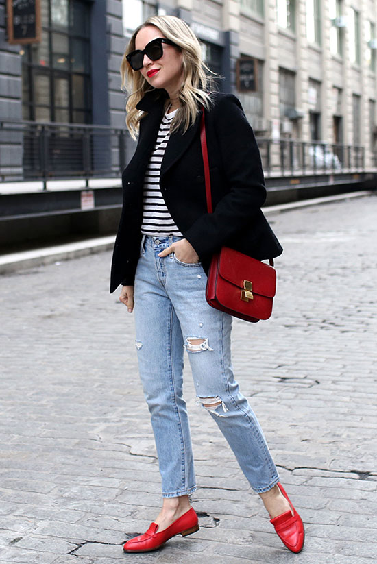 10 Chic Valentine's Outfits For Every Girls Style: Fashion blogger 'Brooklyn Blonde' wearing a black peacoat, a stripe tee, distressed jeans, red loafers, black square sunglasses and a red shoulder bag.