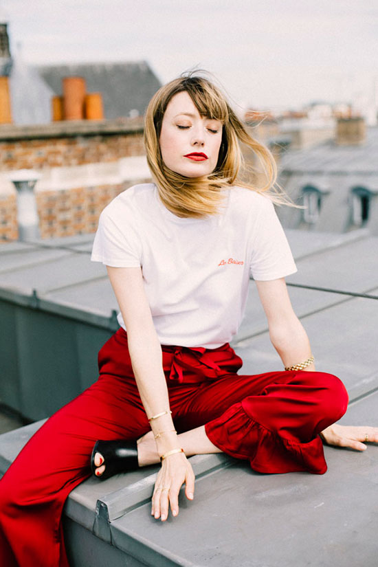 10 Chic Valentine's Outfits For Every Girls Style: Fashion blogger 'Into Your Closet' wearing a white t-shirt, red crop pants and black mule heels.