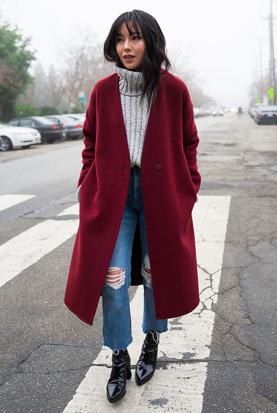 10 Chic Valentine's Outfits For Every Girls Style: Fashion blogger 'The Fancy Pants Report' wearing a red coat, a grey turtleneck sweater, distressed crop jeans and black patent booties.